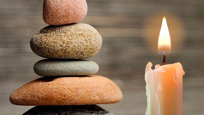 Обряд с камнями, свечой и чёрной тканью